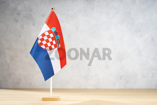 Croatia table flag on white textured wall. Copy space for text, designs or drawings