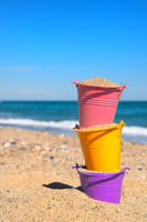 Toy buckets at the beach