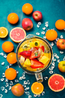 Variation of fruits in mixer. Preparing milkshake or smoothie