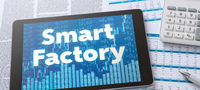 A tablet with financial documents - Smart Factory