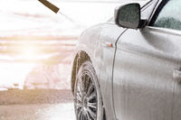 Purifying automobile with touchless technology in exterior carwash.