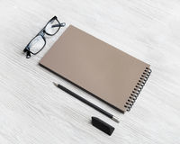 Kraft sketchbook, glasses, pencil, eraser