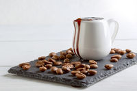 Coffee extract in a porcelain jug.