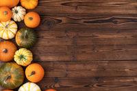 Pumpkin border over rustic wood