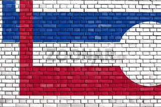 flag of Longmont, Colorado painted on brick wall