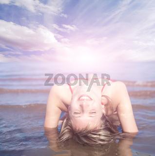 girl aying on the beach enjoying the sea