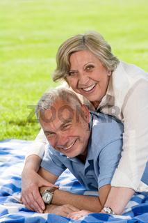 Active retirement senior couple laughing
