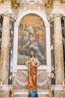 Dubrovnik, Croatia - 04 may 2016: Church of the Vlaha Church inside, in Dubrovnik, Croatia, Europe. Statue of Jesus Christ in marble columns.