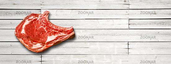 Beef prime rib isolated on white wooden background. Horizontal banner