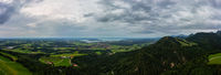 Wide panoramic view over the touristic aera of the Chiemgau alps with the Chiemsee lake next to the horizon.