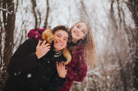 Beautiful young teen couple spending time together outside in cold winter