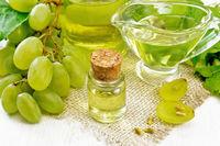 Oil grape in vial on board