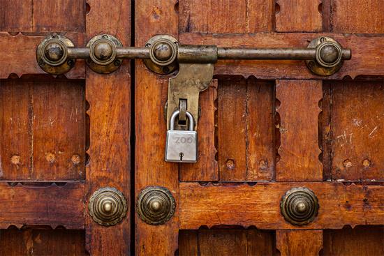 Latch with padlock on door in India