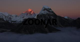 Peak of Mount Everest at sunset.