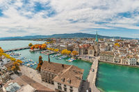 Zurich Switzerland, high angle view city skyline from Grossmunster with autumn foliage season
