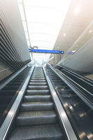 Travelling scene on a train station, public transport: moving staircase and natural lights