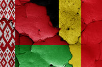 flags of Belarus and Belgium painted on cracked wall