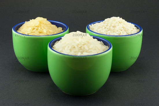 Three varieties of rice in three small green cups