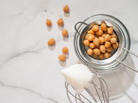 Whipped chickpea aquafaba on planetary mixer whisk