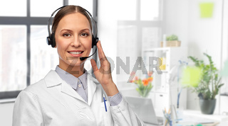 smiling female doctor with headset at hospital