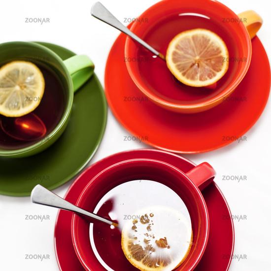 Three colored tea cups