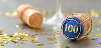 Champagne cap with the Number 100