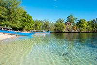 Boats on the beach of the islet of Poyalisa which is part of the Togian archipelago on Sulawesi