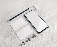 Smartphone, business cards, pencil, eraser