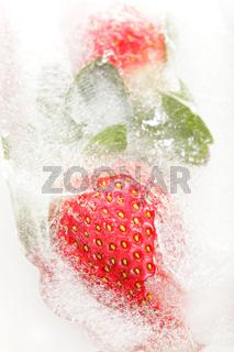 Strawberries partially frosen in ice