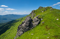 Summer rocky mountain slope. Pikuj Mountain top, Carpathian, Ukraine.