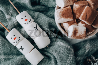 Two happy funny marshmallow snowmen. Marshmallow friends. Diy. Sweet treat for kids funny marshmallow snowman. Christmas winter holiday decoration. Cup of cacao