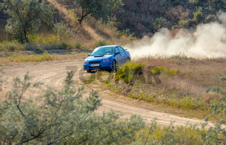 Rally Car on a Turn and a lot of Dust
