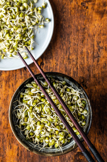 Sprouted green mung beans. Mung sprouts in bowl.
