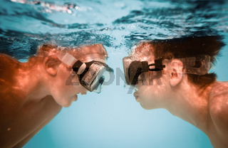 Teenagers under water