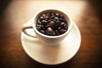 White Coffee Cup with Coffee Beans