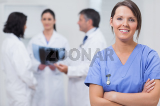 Nurse smiling with her team taking xray seriously