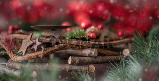 Christmas decorations: wooden wreath with shiny red balls and space for candles
