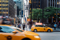 Street Scene in New York City at dusk. Yellow cab