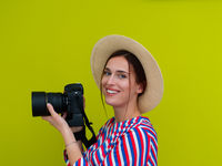 Portrait of beautiful female photographer close up