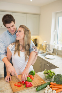 Couple working in the kitchen together
