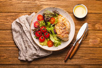 Healthy salad with grilled chicken breast top view