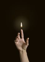 A finger holding a flame.