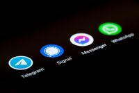 close-up view of app icons of different messaging apps on smartphone display