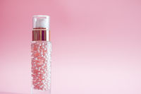 Skincare bottle on pink background, luxury beauty and cosmetic products