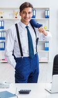 Young stylish businessman working in the office