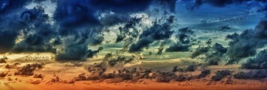 Panoramic view of evening dramatic sky at sunset
