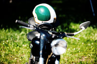 detail of a oldtimer motorcycle with helmet