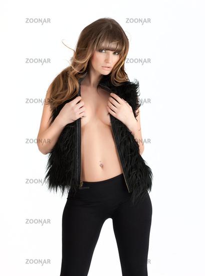 Beautiful sexy girl in fur coat
