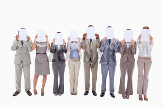 Business people hiding their faces with support for letters