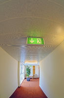 escape route with illuminated signs in a hotel